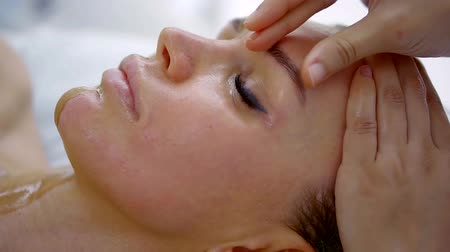 mimos : Close up shot of a woman during face massage at spa. Stock Footage