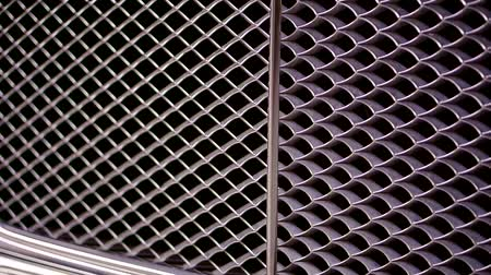 gt : Close up shot of a radiator grill of luxury sportscar.