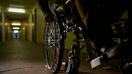 скат : Close up shot of a disabled man on a wheelchair in abandoned scary hospital.