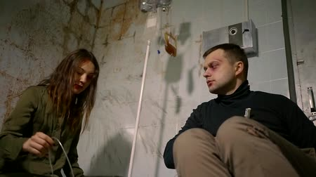 imprisonment : A young woman who looks like a madman offers a disabled person a jar of medicine