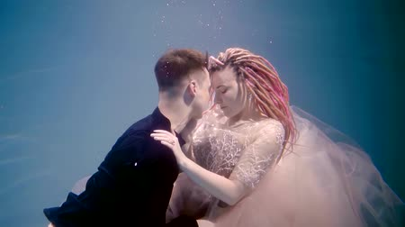 intim : gentle informal cheerleaders are filmed in a love story under the water, they look like fairy-tale characters Stock Footage