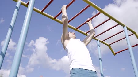 cross training : Athletic exercise in the open air. He climb on the crossbars. Stock Footage