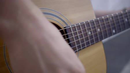 strum : Practicing in playing guitar. Man playing guitar. Close-up