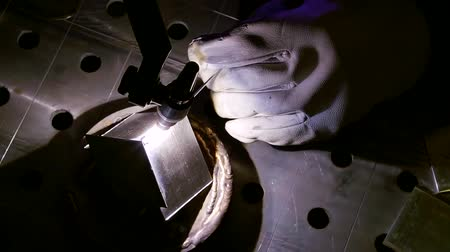 argon : close up shot of a welding machine and a mans hand that works in a factory Stock Footage