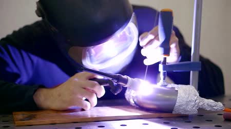 produced : Professional welder is working with a welding machine. Stock Footage