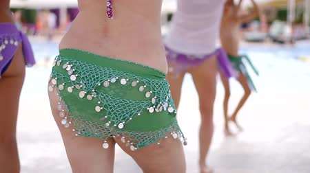 thick : belly dance lesson. shake your belly with obesity at the resort by the pool