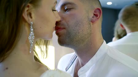 each other : Close up of a young couple looking each other in the eye and then kissing. Closeup of happy man and woman to be affectionate in the room