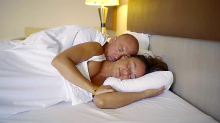 intim : a man and his wife lie in bed, a gentleman basking in with his beloved