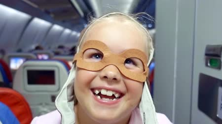 бортовой : funny child in the glasses of the pilot looks into the camera and laughs out loud