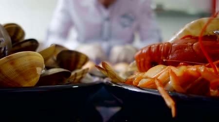 shellfish recipe : chef prepares seafood dishes. shrimp, mussels and crayfish. Asian cuisine Stock Footage