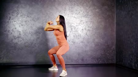 squat : Girl athlete performs an exercise squat in depth without weighting Stock Footage