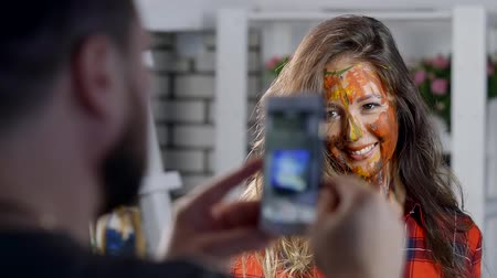 face painting : Portrait of the beautiful girl with amazing smile and art colorful and abstract make-up. Stock Footage