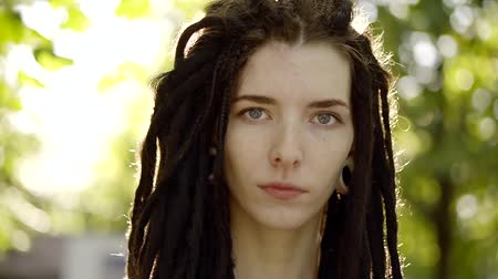 dread : Portrait of a cute teenager with dreadlocks on his head, who seriously looks at the camera