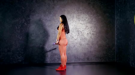 multifunctional : young girl athlete teaches to perform the exercise deadlift with a body bar in his hands. muscle group of the glutes and hamstrings Stock Footage