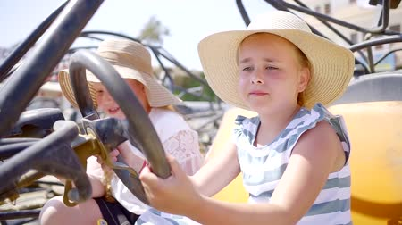 gearstick : Little girl pretending to be a driver in a tourist car in summer on vacation.