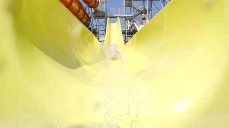 waterslide : Little girl sliding down in a water park.