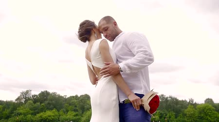 gentleman : Shooting of a fantastic couple dressed in white outdoor in nature in summer. Stock Footage