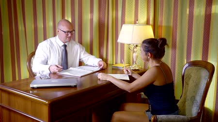 recrutamento : young woman in the office of a family lawyer checks the documents prepared by a specialist Stock Footage