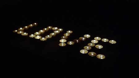 klidný : Words of love written in candles. on black background