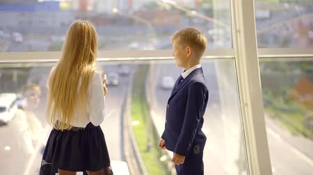 подростковый возраст : Two best friends talking by the big panorama window all dressed up.