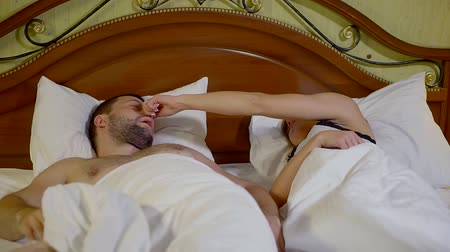 sexualita : Young woman cant sleep at night because man snoring loud. Dostupné videozáznamy