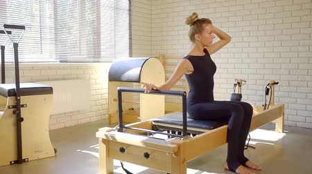 pilates : Athletic woman taking pilates class.
