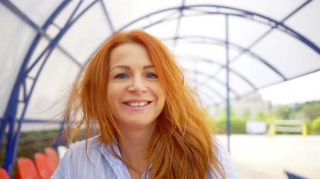 candid laughter : Portrait of cheerful and joyful woman with red hairs, enjoying the day.