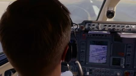 pilot in command : Close-up shot of a professional pilot of a plane landing a plane on a runaway, concentrated.