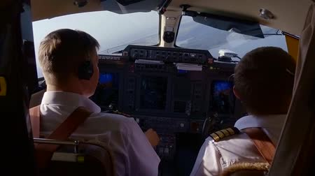 pilot in command : View of two professional man piloting a plane in a nice summer weather. Stock Footage