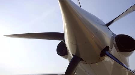 sivil : tilt up view of aircraft screw standing on airport in sunny day, against blue sky