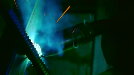 ironworks : Welding tools at work, welder working at metal factory.