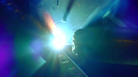 laboring : Close-up shot of a welder working with special tools at work, dozens of sparks. Stock Footage