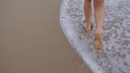 human foot : Woman starts running on beach.