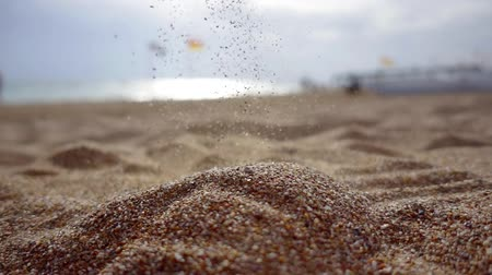 philosopher : sand is pouring on beach in seashore in calm summer day, close-up of flow of grit Stock Footage