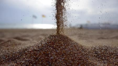 philosopher : sands are falling in a beach on seacoast in daytime, close-up view of flow Stock Footage