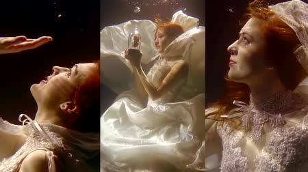 mermaid : Vertical video of a pretty girl with red hair swimming underwater in a white dress like in a fairy tale mermaid