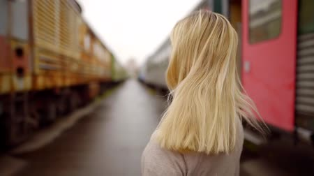 umutlu : portrait of cute blonde girl on the background of old railway depot