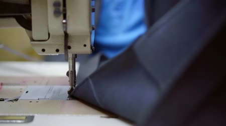 couture : skilled worker is joining leather details of item by sewing machine in industrial workshop Stock Footage