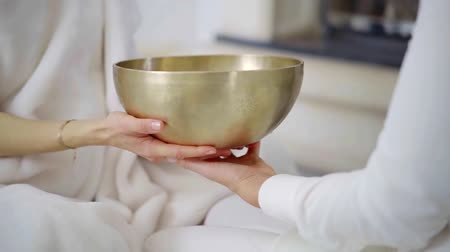 ayurveda : Spa therapist performing sound massage with a singing bowl.