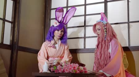 washitsu : Two cute girl girls dressed in anime style: purple and pink hairs, bunny ears and kimono.