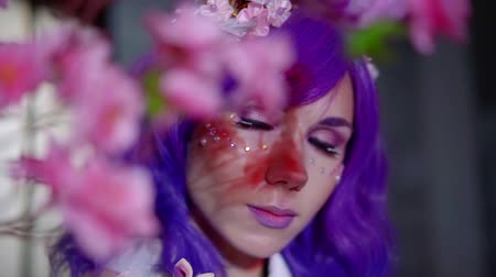 washitsu : Close-up shot of beautiful girl in purple wig with bunny ears posing by the sakura, lovely scene.