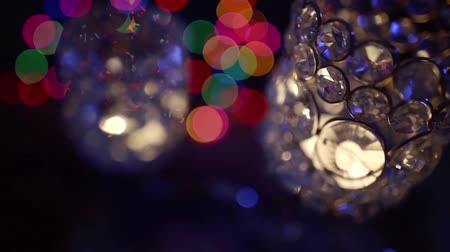 desfocado : lights are reflecting in crystal chandeliers in dark room, blurred and unfocused shot