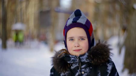 portrait of a cute girl in winter coat with cap hat Stock mozgókép