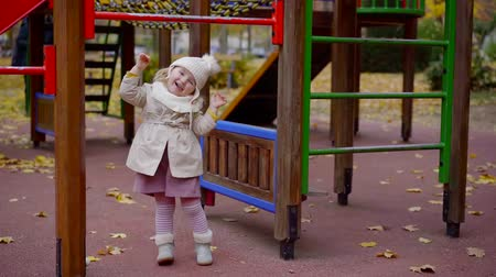 tırmanış : Joyful smiling child enjoying day playing on a playground in autumn.