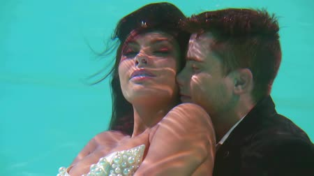 dát : cute love couple hugging underwater like mermaids in fairy tales Dostupné videozáznamy