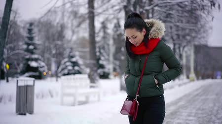 kifejező pozitivitás : Charming brunette woman looking stylish in winter, bright red scarf. Stock mozgókép