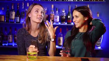 reunir : celebration and lifestyle concept-happy women drinking spirits and talking at the bar Stock Footage