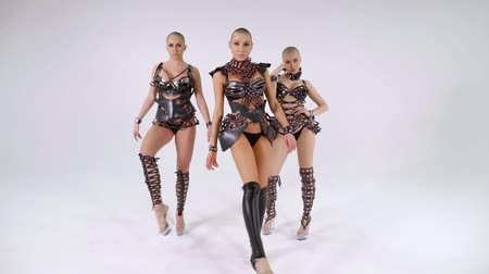 sexo : trio of dancing women are dressed in sexual extravagant leather suits, performing twerk dance