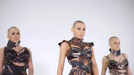 sexo : three similar bald women are moving synchronously, dancing modern dances, wearing lingerie