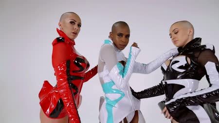 sexo : three multiracial hairless female dancers are dressed in sexual clothes and moving rhythmically